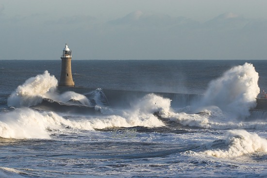 Waves breaking over Tynemouth Lighthouse, River Tyne North Pier.