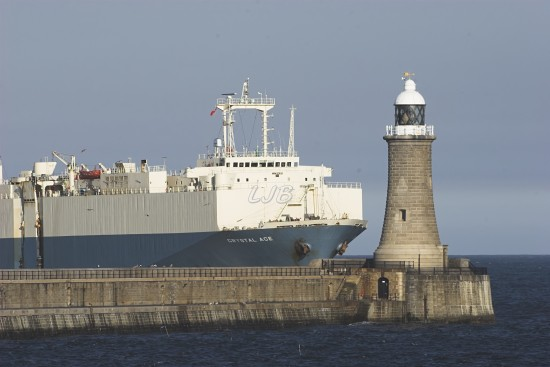 Giant Cargo Ship passing Tynemouth Lighthouse, River Tyne North Pier.